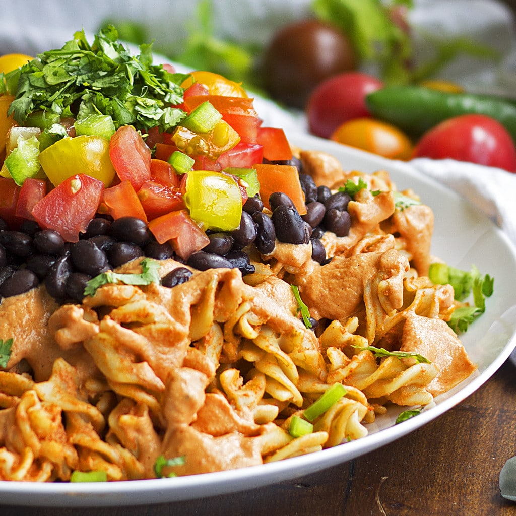 For all you comfort food lovers out there- this one is for you! This Sonora Chicken pasta is drenched in a creamy and spicy sauce, topped with tender chicken, black beans, tomatoes and cilantro. Best of all it's gluten-free, grain-free, dairy-free, and there is a paleo version as well.