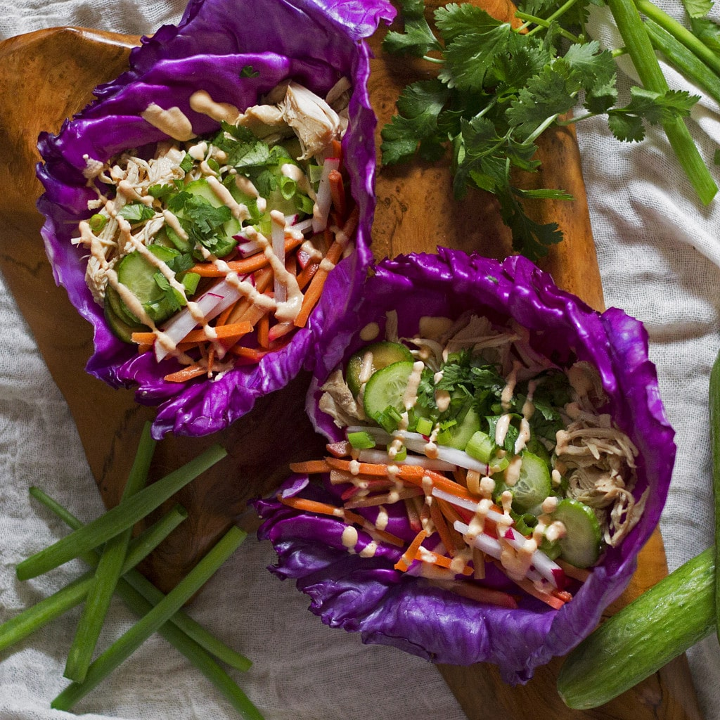 These tasty Banh Mi Chicken Tacos are packed with fresh and bright flavor. They make the perfect healthy weekday dinner. All you got to do is just set it and forget it in the SLOW COOKER and your Banh Mi tacos will be ready by dinner time! This recipe is super easy, and only uses a few simple ingredients but packs a ton of flavor. Add these tacos into your weekly dinner rotation, you will not be disappointed! {Grain-free, Gluten-free, Paleo, Pegan}