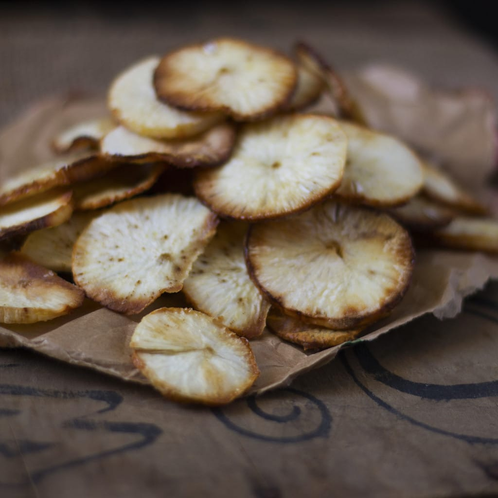 These Yuca Crisps have the perfect combination of crunchy and salty goodness. They make an excellent stand-in for potato or corn chips (in fact they are BETTER and good for you!) and you can make them easily in your own oven!