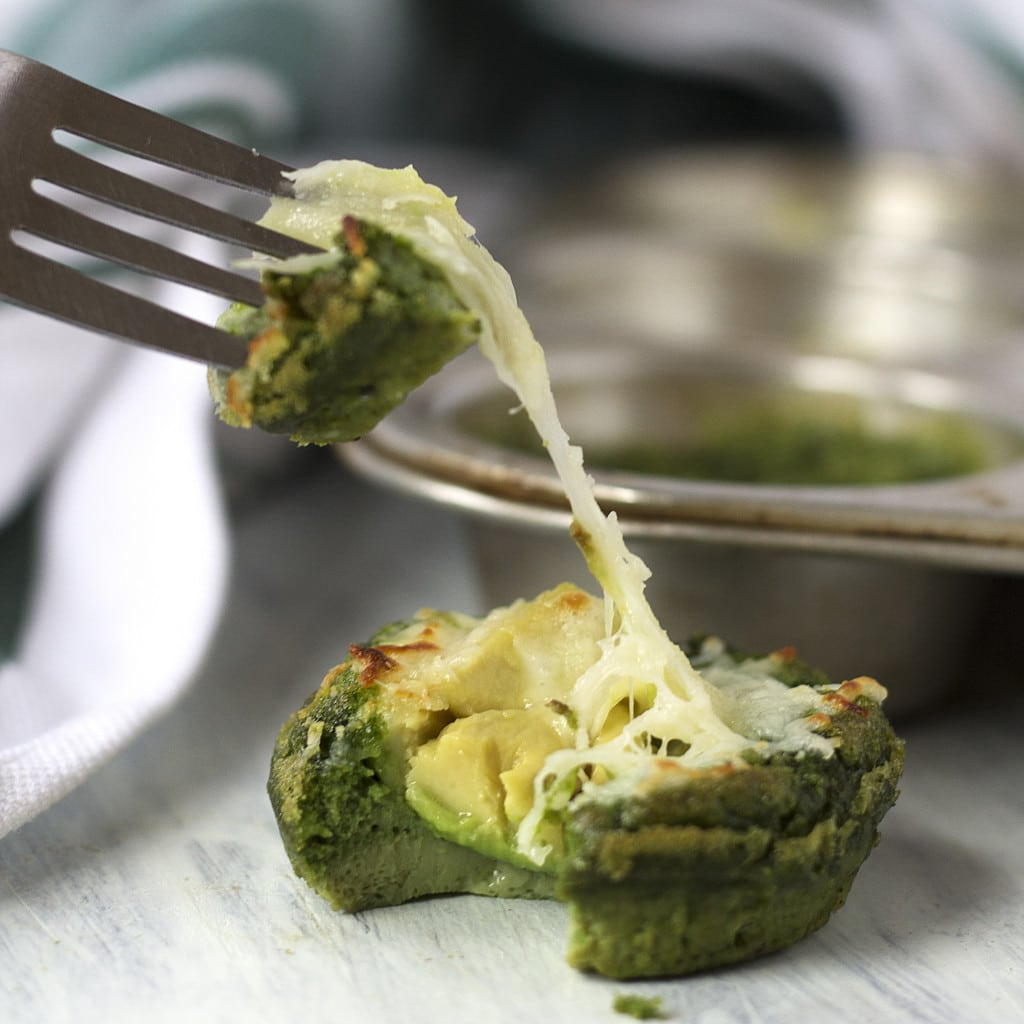 These Green Egg Avocado Stuffed Muffins make the perfect weekday on-the-go breakfast! They are healthy, packed with protein and nutrients, and so very yummy! And they are green, thanks to some nutritious veggies! Don't worry you can't taste the greens, but you can taste the yummy avocado surprise in the middle, along with the ooey gooey melty cheese! Easy, simple and delicious, these egg muffins will be your new favorite breakfast!