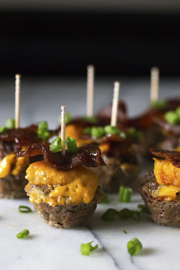 These cute and super tasty Candied Bacon Cheeseburger Bites are the ultimate appetizer for your next party! The amazing flavor combination of sweet, salty, and savory will tantalize your tastebuds and leave you wanting more! They will surely be the hit of the party and don't plan on any leftovers. :)