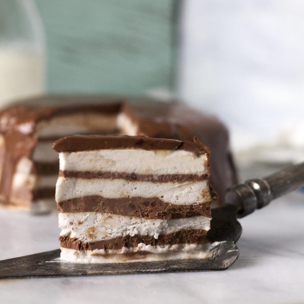 This rich and creamy Chocolate and Banana Cream Ice Cream Cake is made in the blender with only 3 simple ingredients! No way? Yes way! You can whip this up in no time. It looks super fancy, and best of all it's healthy! (dairy-free, paleo, vegan, gluten and grain-free)