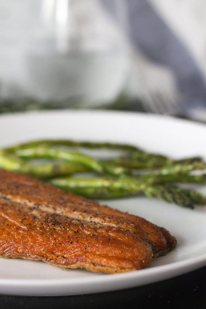 This Extra Crispy Salt and Pepper Salmon is so very delectable and mouth watering. The crisp exterior gives way to tender and succulent buttery salmon that melts in your mouth! With only 3 ingredients and only one pan to clean, it's an easy and healthy meal the entire family will love.
