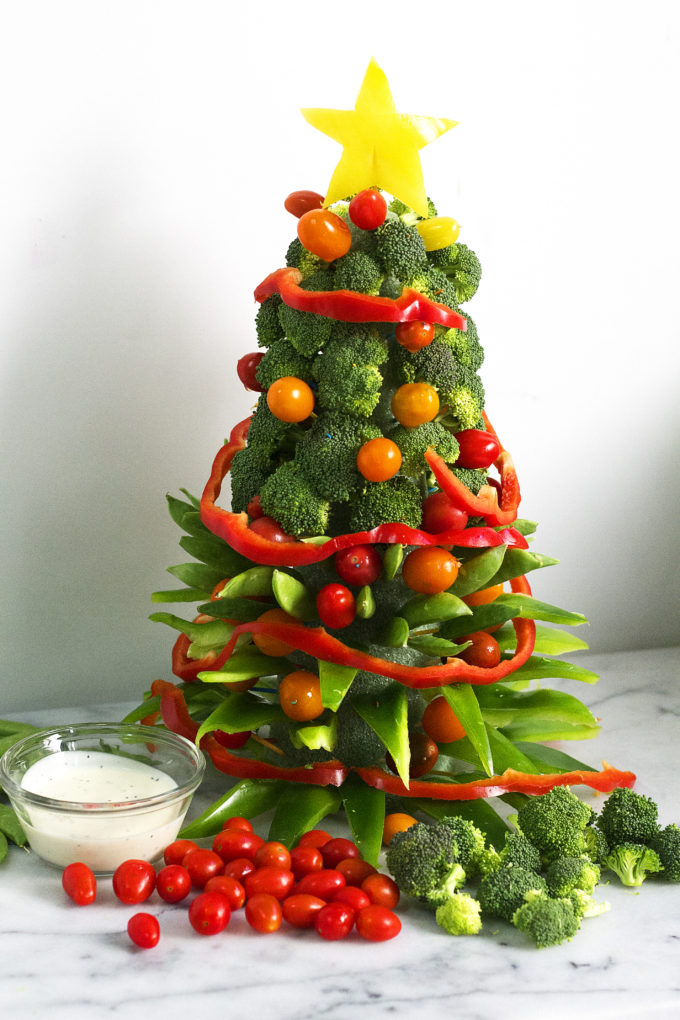 this adorable veggie christmas tree makes the perfect centerpiece and doubles as a healthy appetizer