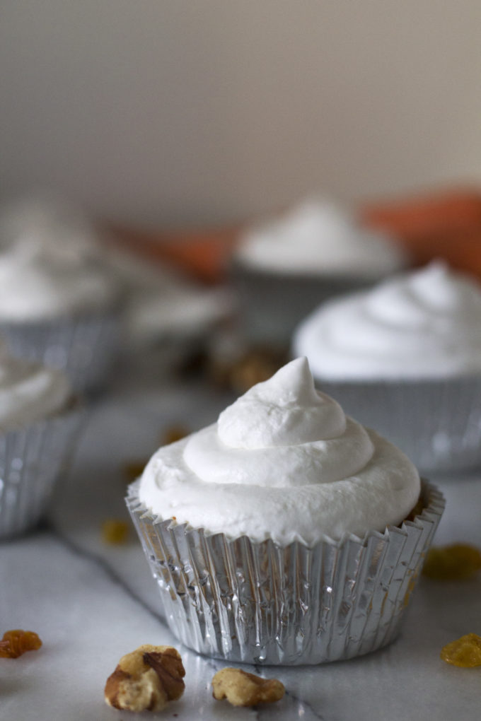 These moist and delicate Carrot Cake Cupcakes, topped with light and fluffy cream cheese whip, have a few surprising ingredients that make them extra special and extra irresistible! They make the perfect secretly healthy sweet treat, and are grain free, gluten free, and paleo.